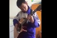 ขั้นเทพ ! เด็กจีนวัย 13 โชว์ทักษะโซโล่กีตาร์ (คลิป)