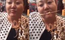 ยี้ขนลุก!! กินได้ไงอะ..หญิงจีนโชว์กินแมงป่องตัวเป็นๆ