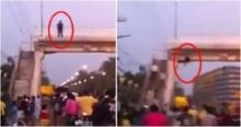 วินาทีหนุ่มคิดสั้น กระโดดสะพานลอย ต่อหน้าไทยมุงนับร้อย